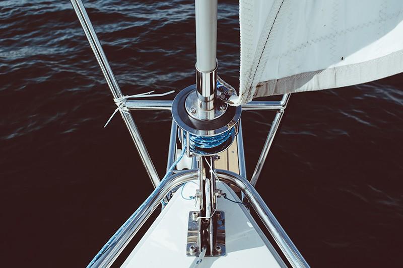 Sailboat mast with ocean underneath